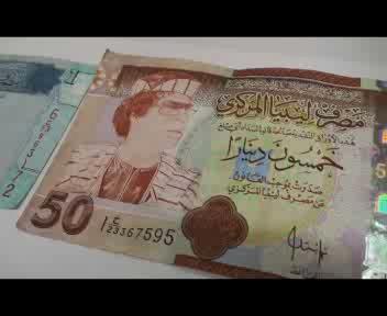 Il regalo più originale? La banconota di Saddam o Gheddafi ...