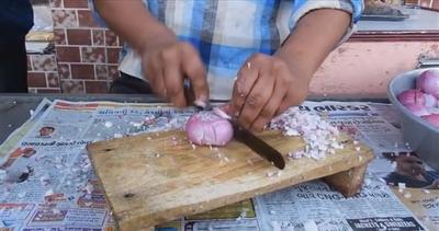 Ecco il taglia-cipolle più veloce del mondo