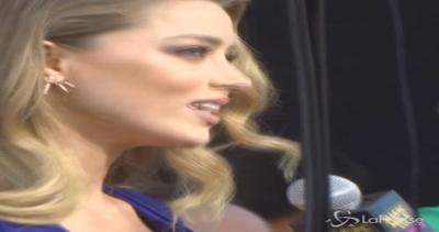 Amber Heard, sexy in blu, cow girl in viaggio e anche pro ...